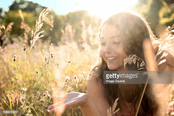 Teenage girl lying in field, close up
