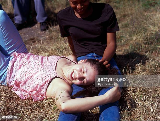 Teenage girl lying on her friend's lap