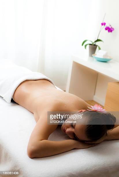 Teenage girl lying on massage table