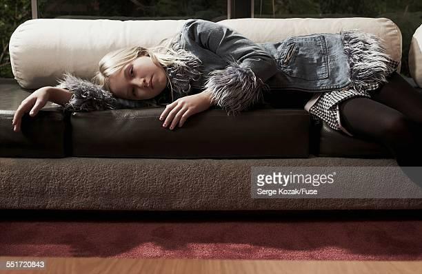 Teenage Girl Lying on Sofa