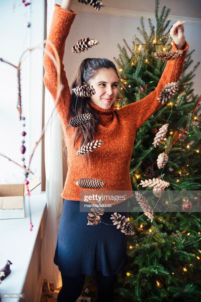 Teenage girl making homemade decoration for Christmas. : Stock Photo