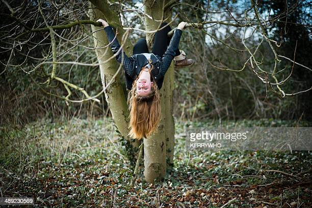 Teenage girl on a playing on a tree