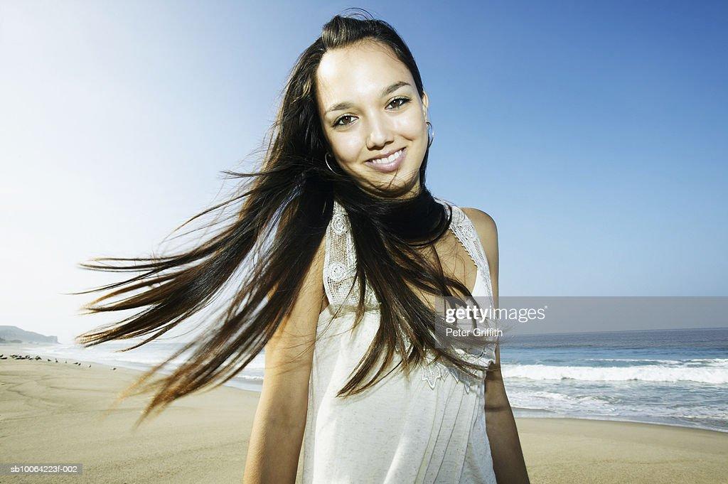 Teenage girl (16-17) on beach, portrait : Stock Photo
