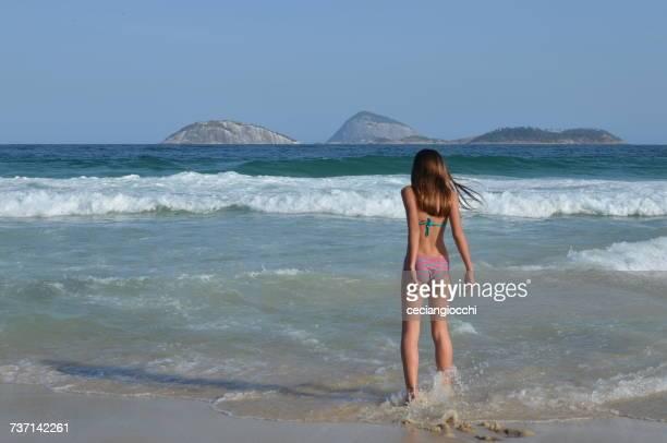 Teenage girl on beach, Rio de Janeiro, Brazil