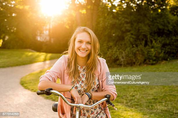 Teenage girl on bike in park