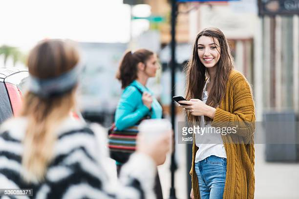 teenage girl on sidewalk in city - stranger stock photos and pictures