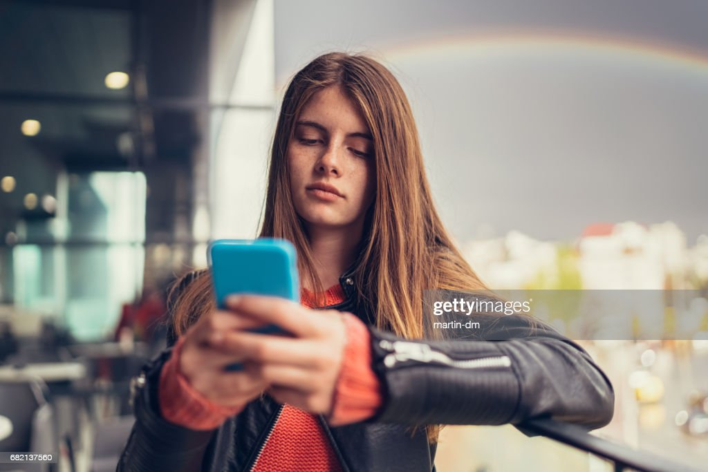Image result for bored teenager texting getty images