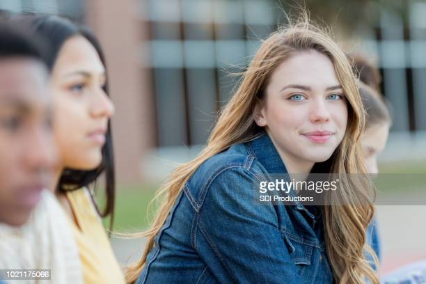teenage girl outdoors on school campus - teenage girls stock pictures, royalty-free photos & images