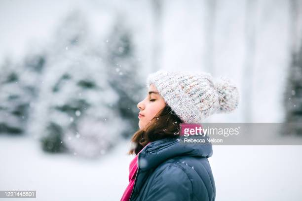 teenage girl outside in snowy weather - rebecca nelson stock pictures, royalty-free photos & images