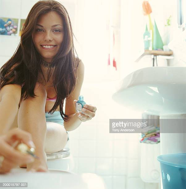 teenage girl (16-18) painting toenails - teen girls toes stock photos and pictures