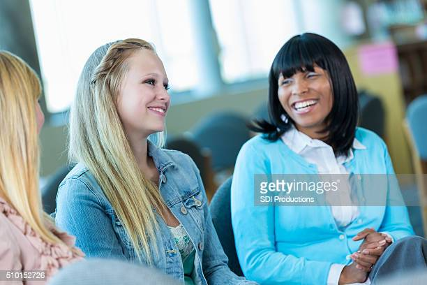 Teenage girl participates in group therapy