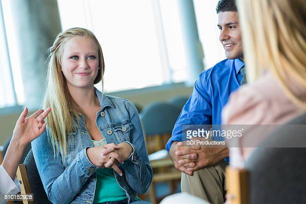 Teenage girl participates in group therapy session