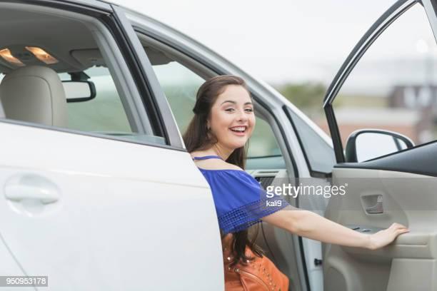 Teenage girl, passenger looking out car door