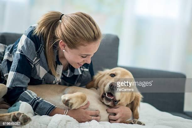 Teenage Girl Petting Her Dog