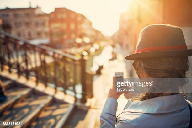 teenage girl photographing in venice, italy - fedora stock pictures, royalty-free photos & images