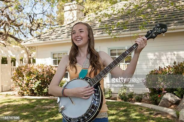 Teenage girl playing banjo