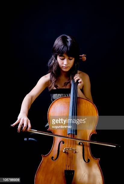 Teenage girl playing cello