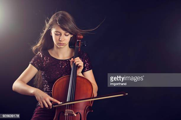 teenage girl playing cello - stringed instrument stock pictures, royalty-free photos & images