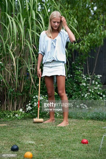 Teenage girl playing croquet, Sweden