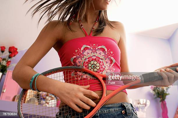 Teenage Girl Playing Guitar on Tennis Racket