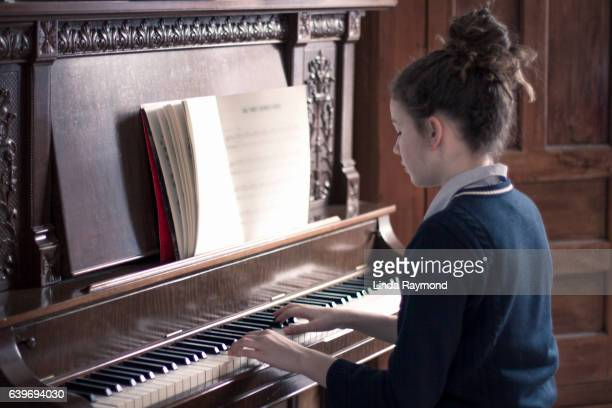 teenage girl playing piano - piano player stock photos and pictures