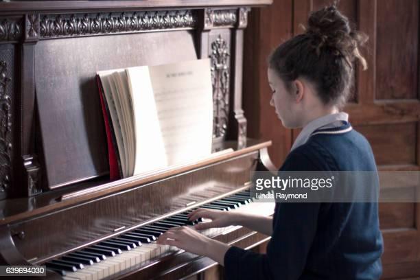Teenage girl playing piano