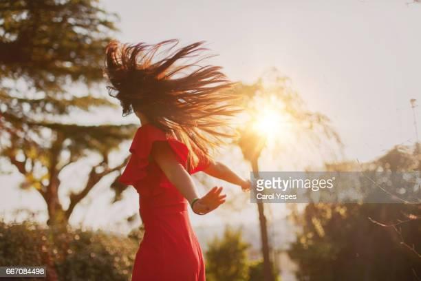 teenage girl playing with hair sunset