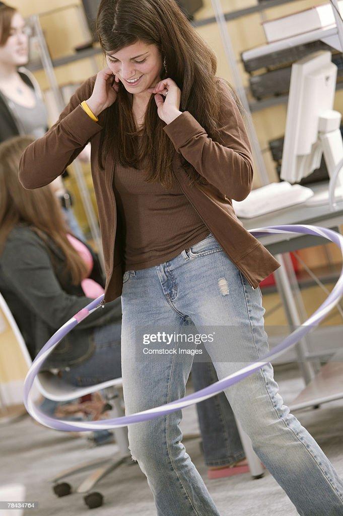Teenage girl playing with plastic hoop : Stockfoto