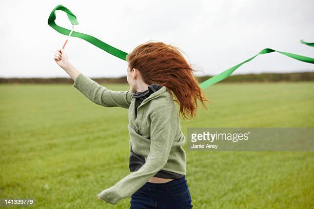 Teenage girl playing with ribbon