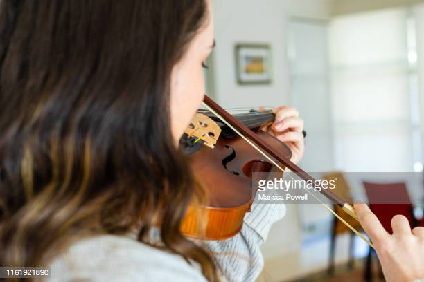 teenage girl plays the violin - violin stock pictures, royalty-free photos & images