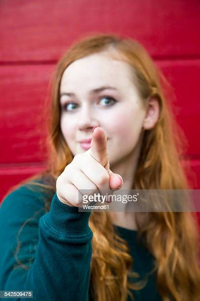 Teenage girl pointing on viewer