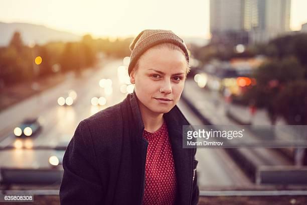 Teenage girl posing at the bridge