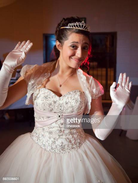 teenage girl posing in quinceanera dress - prinzessin stock-fotos und bilder