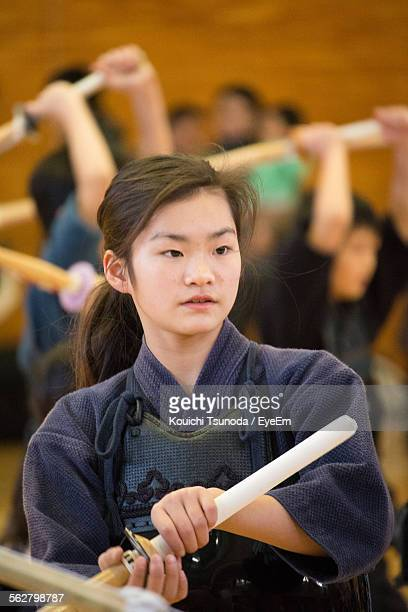 Teenage Girl Practicing Kendo