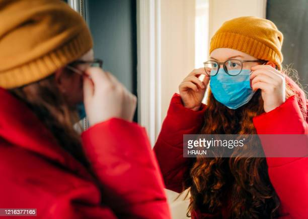 teenage girl preparing for school wearing protective mask - spectacles stock pictures, royalty-free photos & images