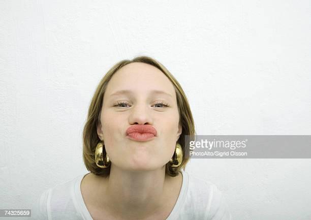 Teenage girl puckering lips at camera