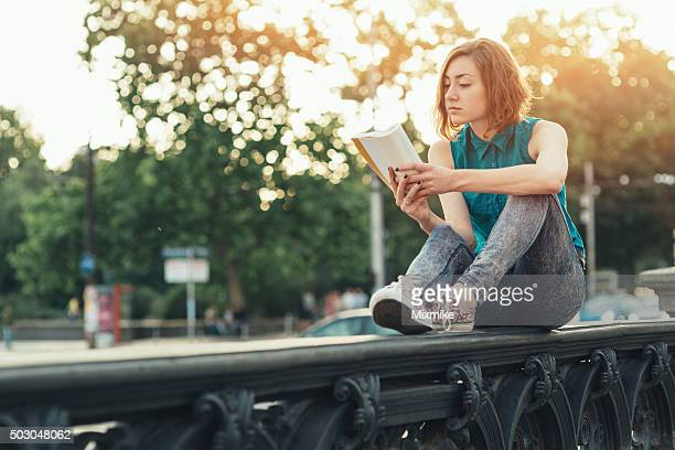 teenage girl reading a book - literature stock pictures, royalty-free photos & images