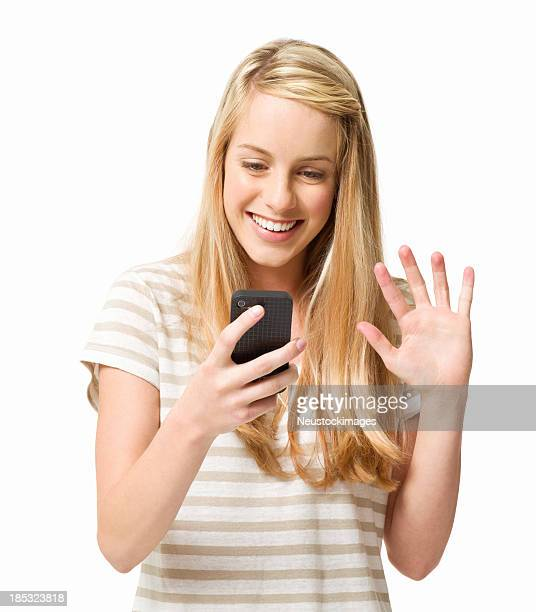 Teenage Girl Reading From Her Cellphone - Isolated