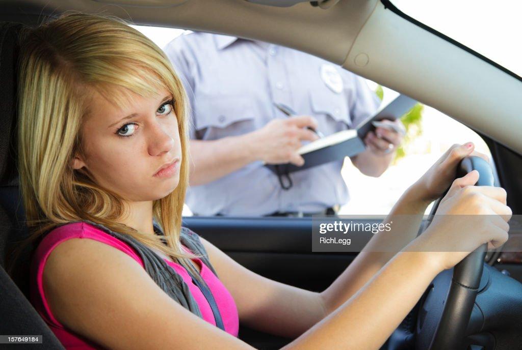 Teenage Girl Receiving a Ticket : Stock Photo