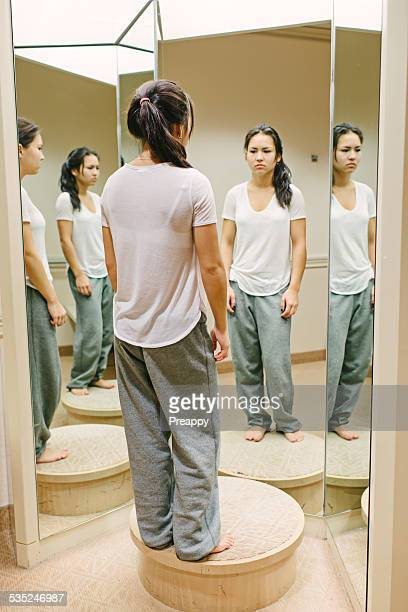 teenage girl reflecting in front of mirror - girl in mirror stock-fotos und bilder