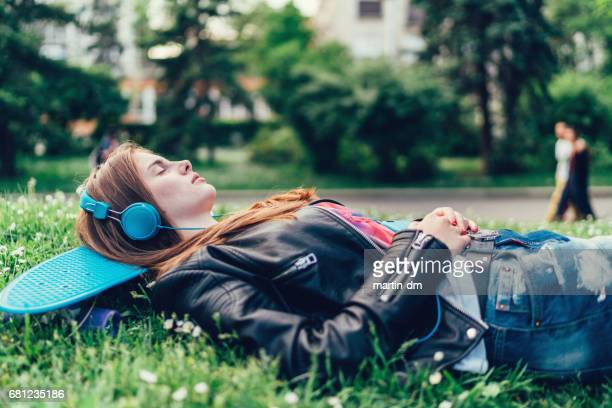Teenage girl relaxing in the park