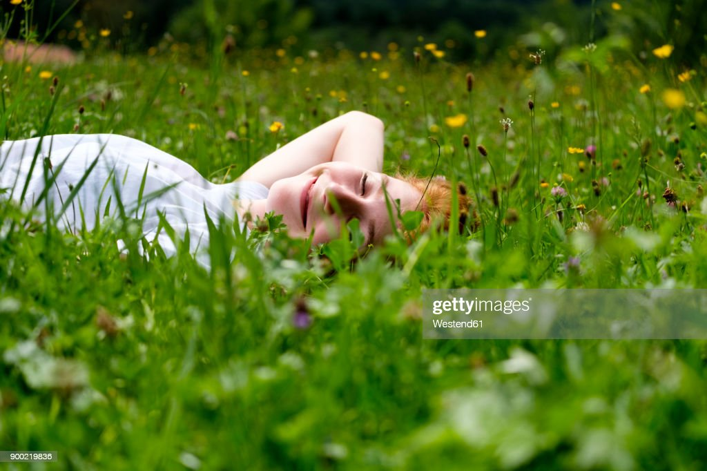 Teenage girl relaxing on a meadow : Stock Photo