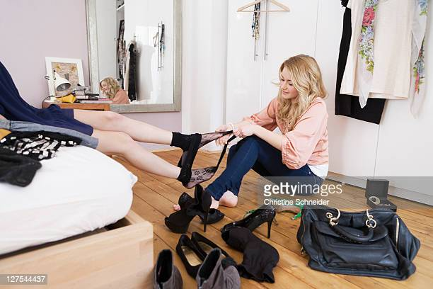 teenage girl removing friendâs tights - girl strips stock pictures, royalty-free photos & images