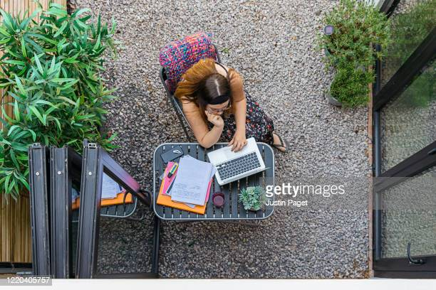 teenage girl revising outdoors - the internet stock pictures, royalty-free photos & images