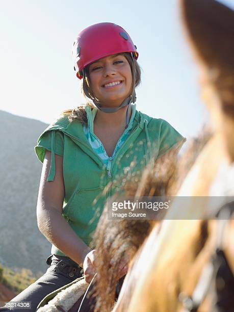 teenage girl riding horse - riding hat stock pictures, royalty-free photos & images