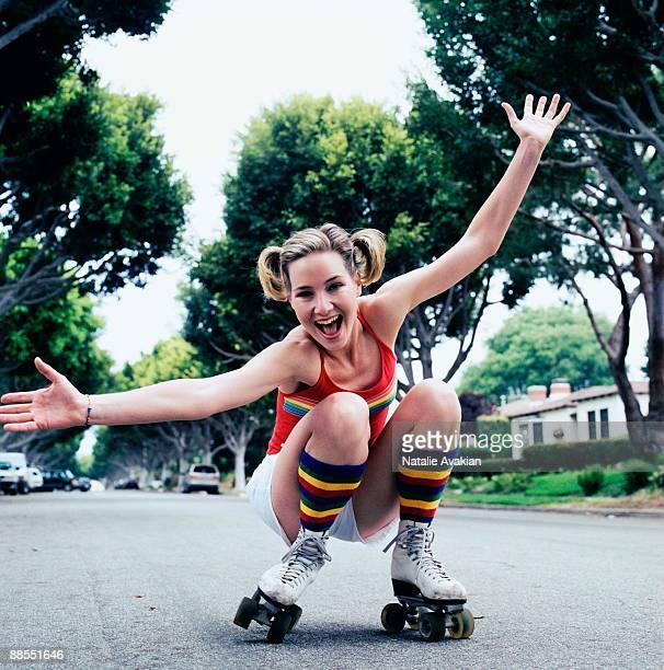 Teenage girl rollerskating