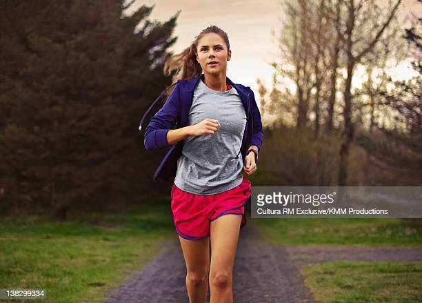 Teenage girl running in park