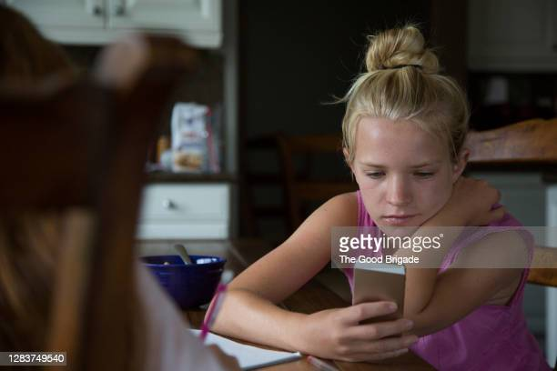 teenage girl sending text message on smart phone - facebook stock pictures, royalty-free photos & images