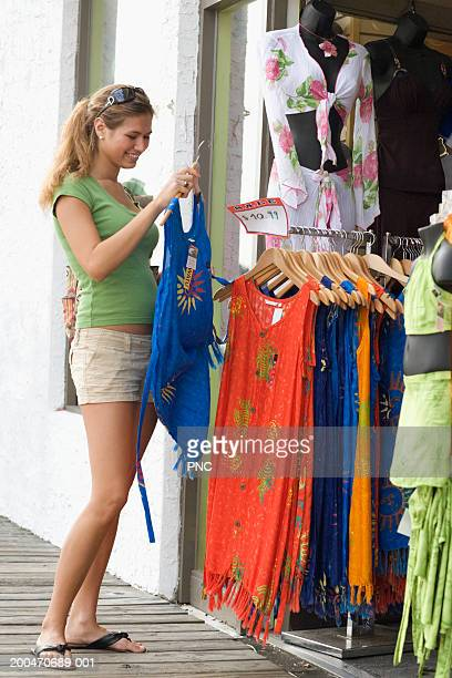 teenage girl (16-18) shopping at retail store, side view - ocean city new jersey stock photos and pictures