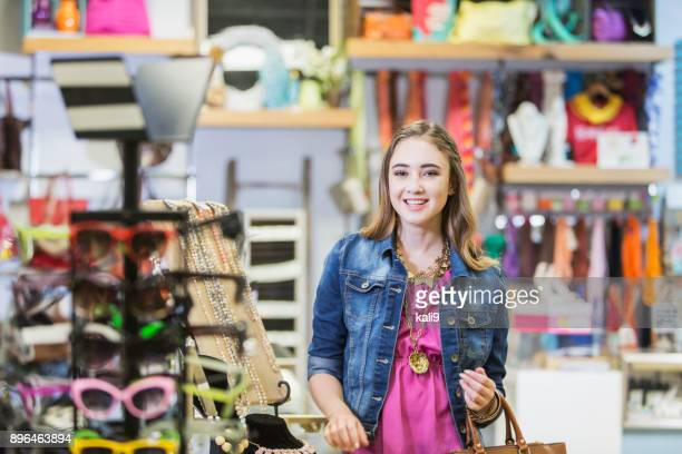 teenage girl shopping at the mall - gift shop stock pictures, royalty-free photos & images